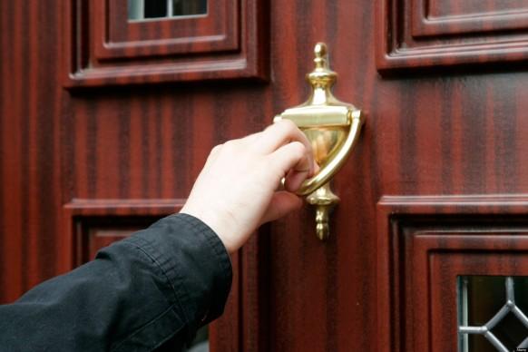 mans hand using door